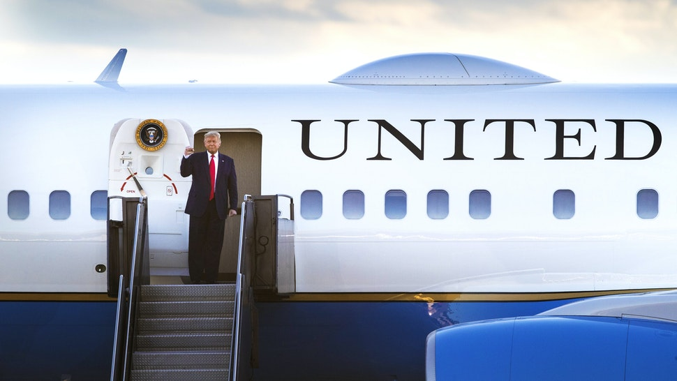 Bloomberg Best Of U.S. President Donald Trump 2017 - 2020: U.S. President Donald Trump gestures while disembarking Air Force One ahead of a campaign rally at the Pro Star Aviation hangar in Londonderry, New Hampshire, U.S., on Friday, Aug. 28, 2020. Our editors select the best archive images looking back at Trumps 4 year term from 2017 - 2020.