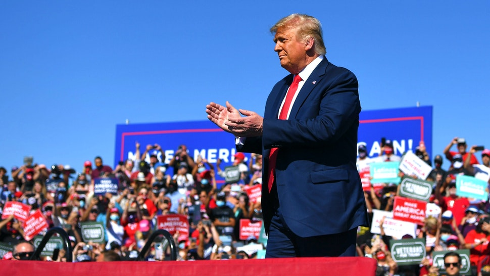 """US President Donald Trump gestures on stage during a rally at Prescott Regional Airport in Prescott, Arizona on October 19, 2020. - US President Donald Trump went after top government scientist Anthony Fauci in a call with campaign staffers on October 19, 2020, suggesting the hugely respected and popular doctor was an """"idiot."""""""