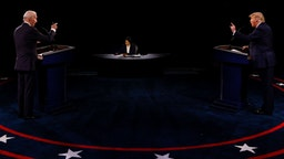 U.S. President Donald Trump, right, and Joe Biden, 2020 Democratic presidential nominee, speak during the U.S. presidential debate at Belmont University in Nashville, Tennessee, U.S., on Thursday, Oct. 22, 2020. Trump and Biden traded charges of secretly taking money from foreign interests, after the former vice president addressed head-on Trumps efforts to portray him as corrupt. Photographer: Jim Bourg/Reuters/Bloomberg via Getty Images