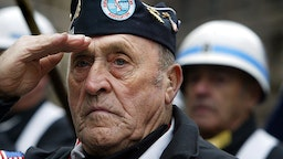 NEW YORK - NOVEMBER 11: U.S. Army Korean War veteran Joseph Meunier salutes during a Veterans Day Wreath Ceremony November 11, 2003 in New York City. (Photo by Mario Tama/Getty Images)