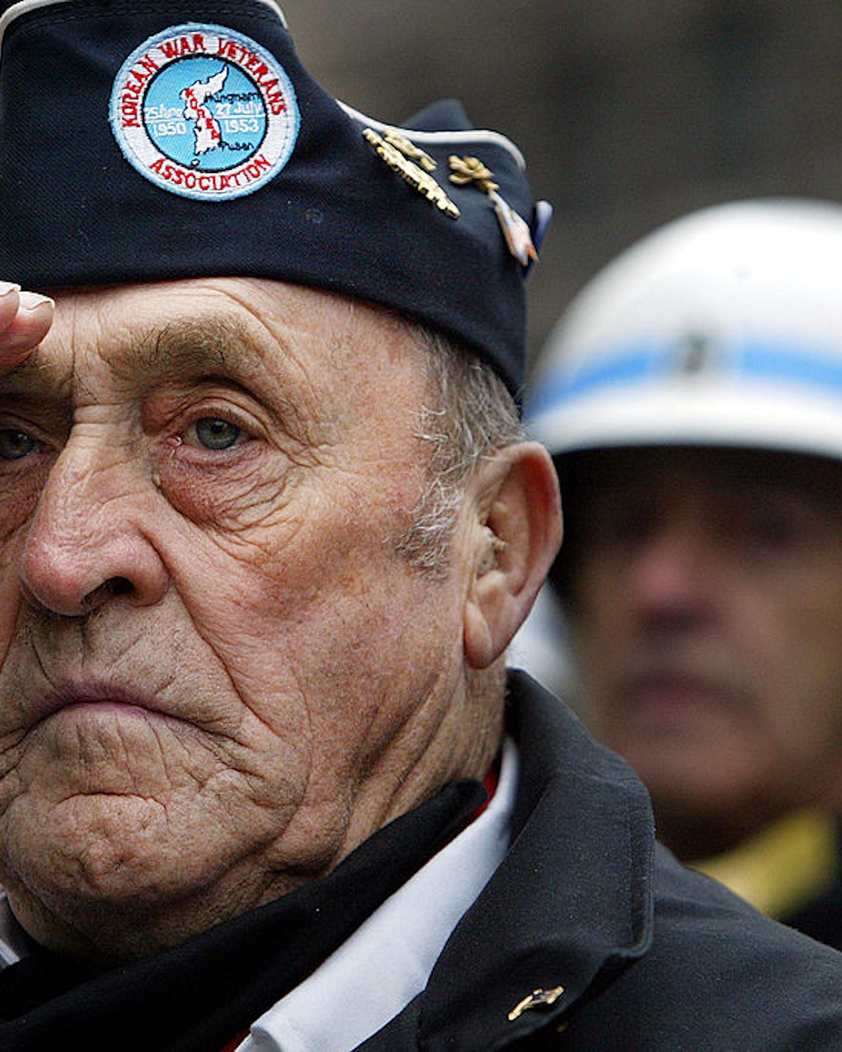 NEW YORK - NOVEMBER 11: U.S. Army Korean War veteran Joseph Meunier salutes during a Veterans Day Wreath Ceremony November 11, 2003 in New York City. (Photo by Mario Tama/Getty Images)