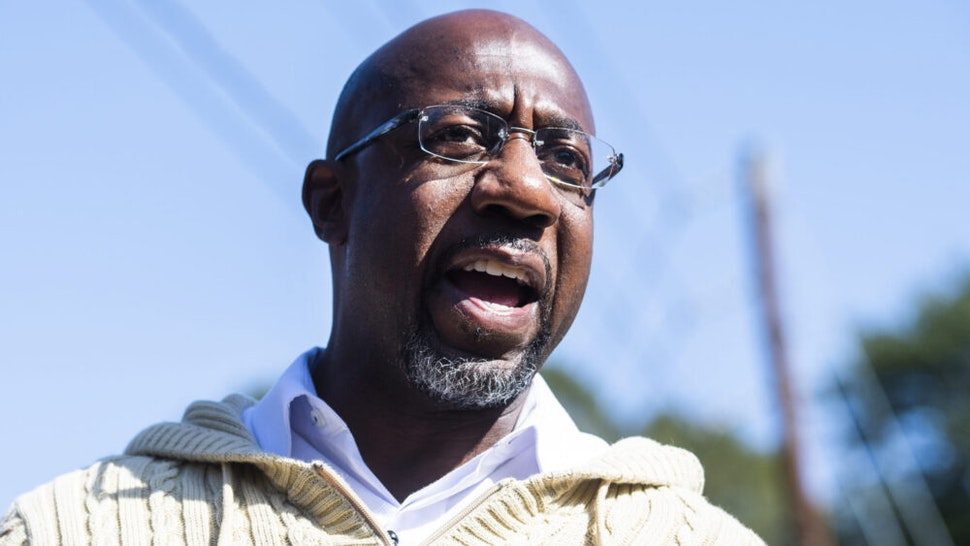 UNITED STATES - NOVEMBER 3: Rev. Raphael Warnock, Democratic candidate for Georgia senate, speaks with supporters during a campaign stop near Coan Park in Atlanta, Ga., on Tuesday, November 3, 2020.