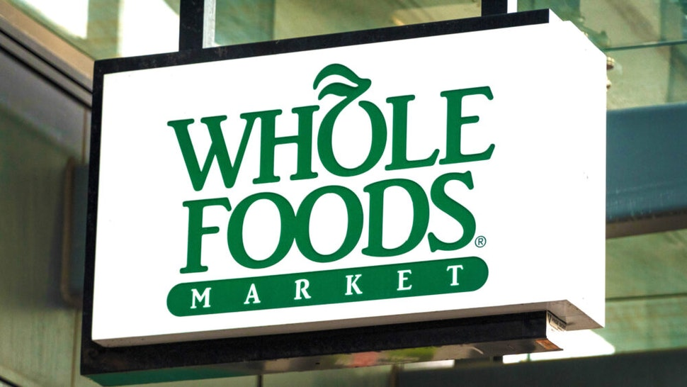TORONTO, ONTARIO, CANADA - 2017/10/22: Whole Foods sign hanging on a store entrance in Yonge Street. The company was recently acquired by Amazon.