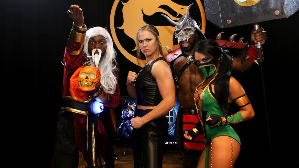LOS ANGELES, CALIFORNIA - JANUARY 17: (L-R) Kofi Kingston, Ronda Rousey, Xavier Woods, and Zelina Vega attend Mortal Kombat 11: The Reveal on January 17, 2019 in Los Angeles, California. (Photo by Tasia Wells/Getty Images for Warner Bros. Interactive Entertainment)