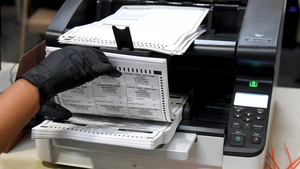 NORTH LAS VEGAS, NEVADA - NOVEMBER 07: A Clark County election worker scans mail-in ballots at the Clark County Election Department on November 7, 2020 in North Las Vegas, Nevada. Joe Biden won Pennsylvania and Nevada and was declared the winner in the presidential race against Donald Trump.