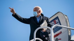NEW CASTLE, DE - NOVEMBER 02: Democratic presidential nominee Joe Biden boards his campaign plane at New Castle Airport on November 02, 2020 in New Castle, Delaware. One day before the election, Biden is campaigning in Ohio and Pennsylvania, a key battleground state that President Donald Trump won narrowly in 2016. (Photo by