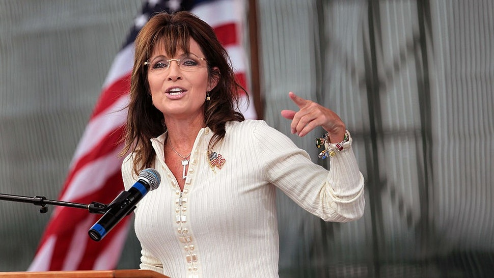 """INDIANOLA, IA - SEPTEMBER 03: Former Alaska Governor Sarah Palin speaks to supporters during the Tea Party of America's """"Restoring America"""" event at the Indianola Balloon Festival Grounds September 3, 2011 in Indianola, Iowa. Yesterday Palin attended a Conservatives4Palin event. She is scheduled to speak at another Tea Party event in New Hampshire on Monday. The stops continue to fuel speculation that the former governor will run for president, a decision which she said she would make by the end of September. (Photo by"""