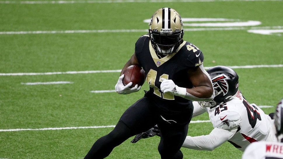 NEW ORLEANS, LOUISIANA - NOVEMBER 22: Alvin Kamara #41 of the New Orleans Saints carries the ball in for a touchdown as Deion Jones #45 of the Atlanta Falcons fails to make the tackle in the second quarter at Mercedes-Benz Superdome on November 22, 2020 in New Orleans, Louisiana. (Photo by