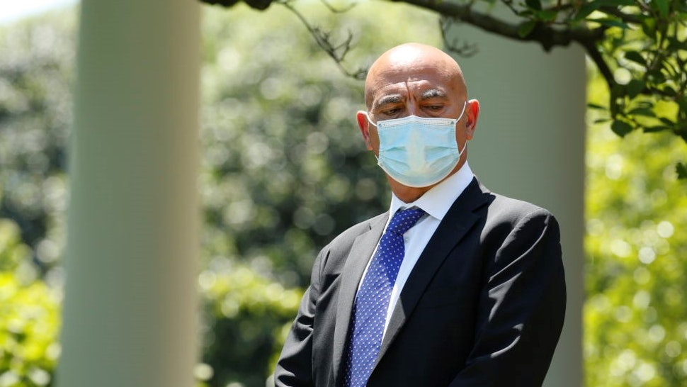 Moncef Slaoui, former executive at GlaxoSmithKline Plc, wears a protective mask while U.S. President Donald Trump, not pictured, speaks during an event at the White House in Washington, D.C., U.S., on Friday, May 15, 2020. Trump officially introduced Slaoui and a four star-general who will lead his crash coronavirus vaccine effort, amid a whistle-blower's criticism that the administration lacked a plan to combat the outbreak. Photographer: