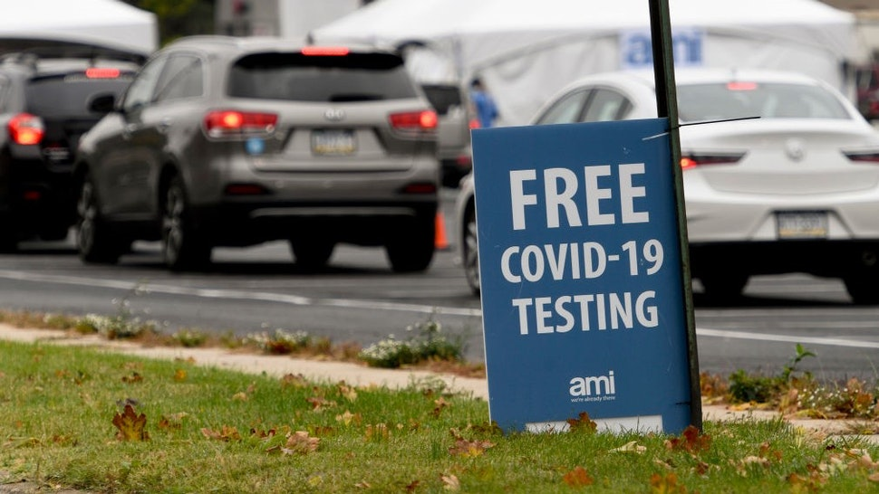 """Reading, PA - October 13: A sign that reads """"Free COVID-19 Testing"""". At the state run free COVID-19 testing site setup on Front Street in Reading, PA outside FirstEnergy Stadium Tuesday morning October 13, 2020. The site will be there for 5 days and was setup in response to an increase in cases in Berks County. (Photo by"""