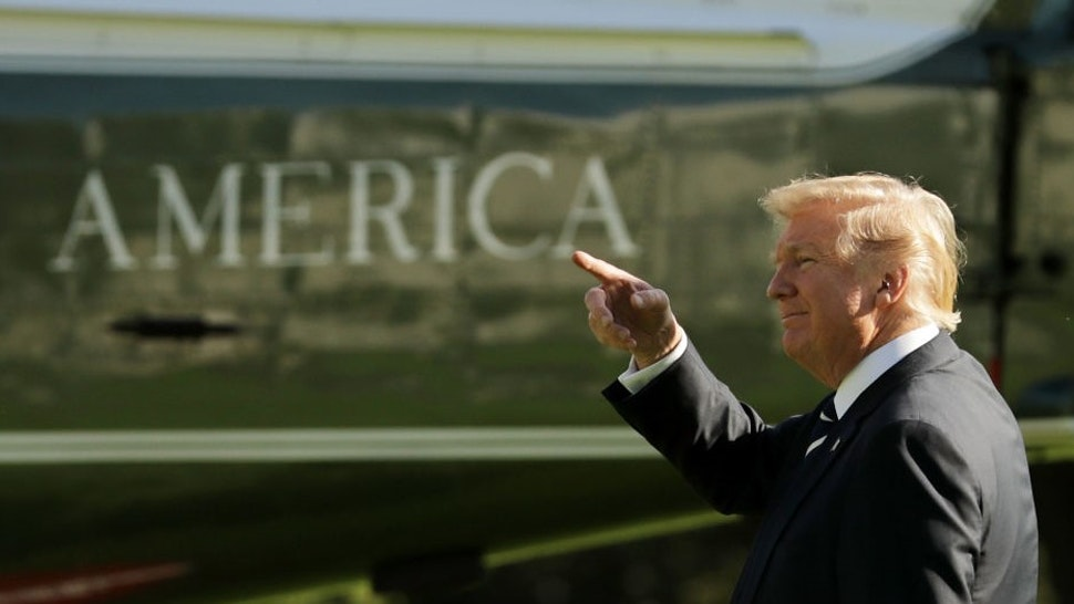 WASHINGTON, DC - OCTOBER 16: U.S. President Donald Trump points as he walks across the South Lawn before departing the White House on Marine One October 16, 2017 in Washington, DC. Trump is traveling to South Carolina to attend a fund raising event for GOP gubernatorial candidate Henry McMaster. (Photo by