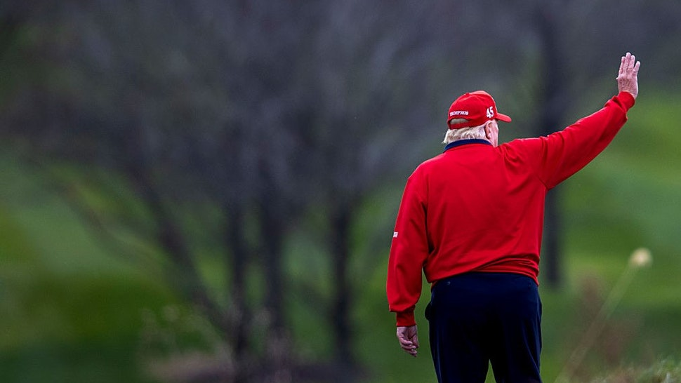 STERLING, VIRGINIA - NOVEMBER 27: US President Donald Trump walks to Marine One after golfing at Trump National Golf Club on November 27, 2020 in Sterling, Virginia. President Trump heads to Camp David for the weekend after playing golf. (Photo by