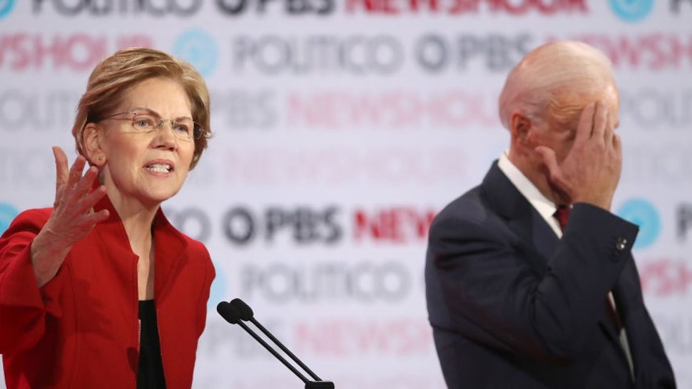 LOS ANGELES, CALIFORNIA - DECEMBER 19: Sen. Elizabeth Warren (D-MA) speaks as former Vice President Joe Biden listens during the Democratic presidential primary debate at Loyola Marymount University on December 19, 2019 in Los Angeles, California. Seven candidates out of the crowded field qualified for the 6th and last Democratic presidential primary debate of 2019 hosted by PBS NewsHour and Politico. (Photo by