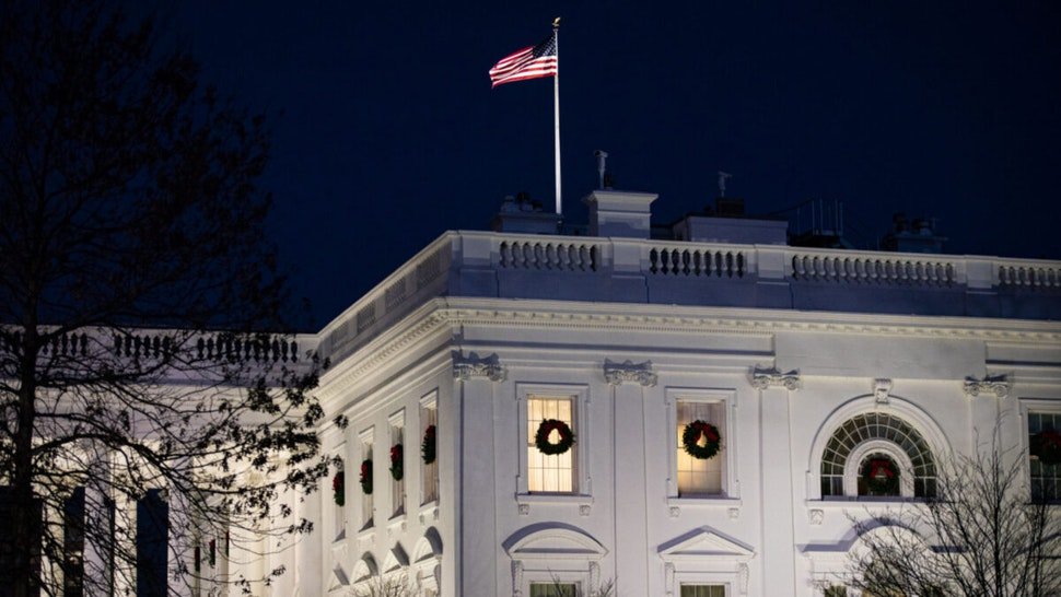 The White House at night in Washington, D.C., U.S., on Friday, Dec. 11, 2020.