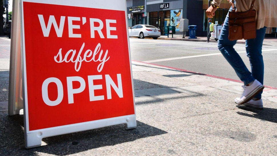 """A sign announces that a restaurant is """"safely open"""" in Los Angeles, California on June 24, 2020 amid a record rise in coronavirus cases across the state."""