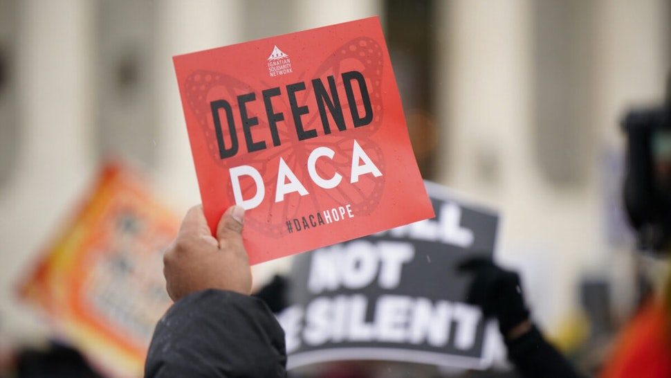 Immigration rights activists take part in a rally in front of the US Supreme Court in Washington, DC on November 12, 2019.