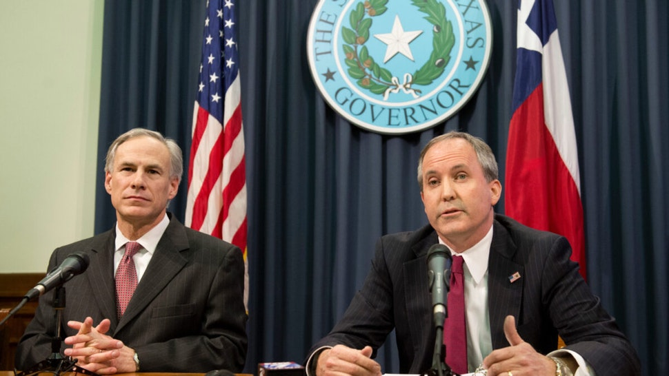 Texas Gov. Greg Abbott, l, and Attorney General Ken Paxton hold a press conference to address a Texas federal court's decision on the immigration lawsuit filed by 26 states challenging President Obama.