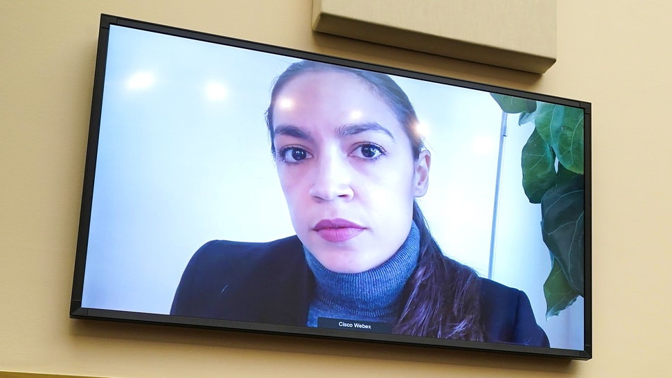 Representative Alexandria Ocasio-Cortez, a Democrat from New York, speaks via videoconference during a House Financial Services Committee hearing in Washington, D.C., U.S., on Wednesday, Dec. 2 2020. Powelland Mnuchin both backed more fiscal stimulus to bridge the U.S. economy through the next few months of the pandemic amid promise for Covid-19 vaccines.