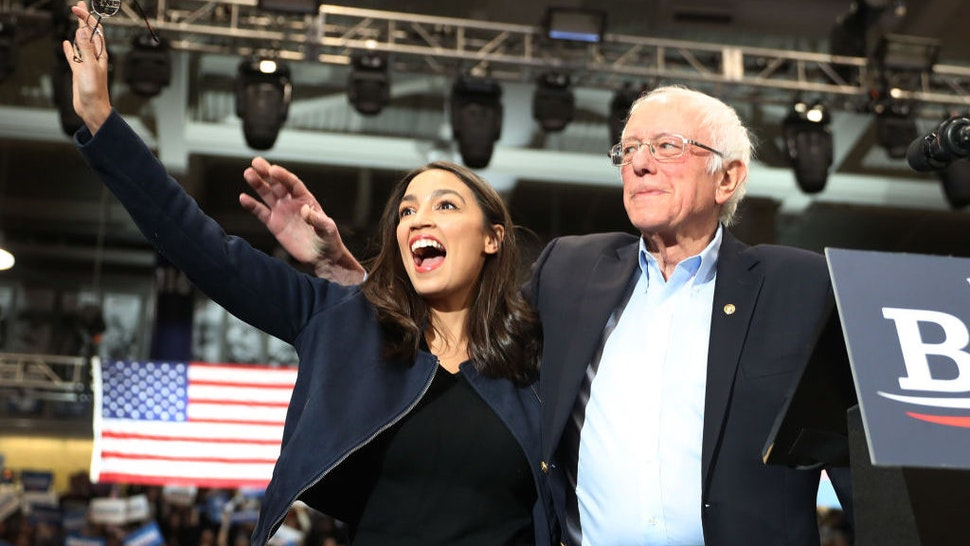 DURHAM, NEW HAMPSHIRE - FEBRUARY 10: U.S. Rep. Alexandria Ocasio-Cortez (D-N.Y) and Democratic presidential candidate Sen. Bernie Sanders (I-VT) stand together during his campaign event at the Whittemore Center Arena on February 10, 2020 in Durham, New Hampshire. The state's Democratic primary is tomorrow. (Photo by Joe Raedle/Getty Images)