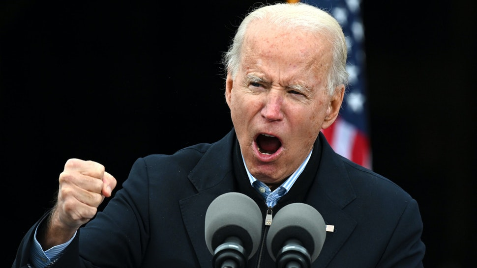 TOPSHOT - US President-elect Joe Biden gestures as he speaks during a campaign rally to support Democratic Senate candidates in Atlanta, Georgia on December 15, 2020. - US President-elect Joe Biden travelled to Georgia to campaign for Democratic Senate candidates Jon Ossoff and Reverend Raphael Warnock.
