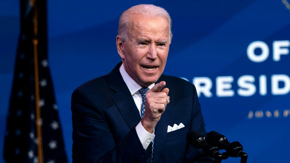 US President-Elect Joe Biden talks to reporters after delivering remarks, before the holiday, at The Queen in Wilmington, Delaware on December 22, 2020.
