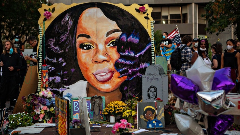 LOUISVILLE, KY - SEPTEMBER 26: People gather at Breonna Taylors make shift memorial in Injustice Square Park in downtown Louisville on Saturday, Sept. 26, 2020 in Louisville, KY.