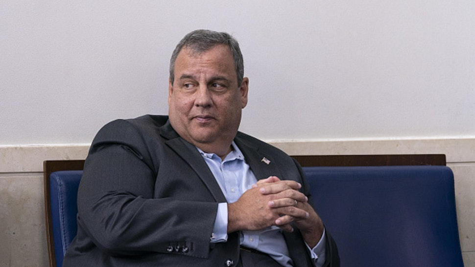 Chris Christie, former Governor of New Jersey, listens as U.S. President Donald Trump speaks during a news conference in the James S. Brady Press Briefing Room at the White House in Washington, D.C., U.S., on Sunday, Sept. 27, 2020. Trump denied a report that he paid just $750 in federal income taxes in 2016 and 2017, and repeated his stance to only share his tax returns after an audit is finished.