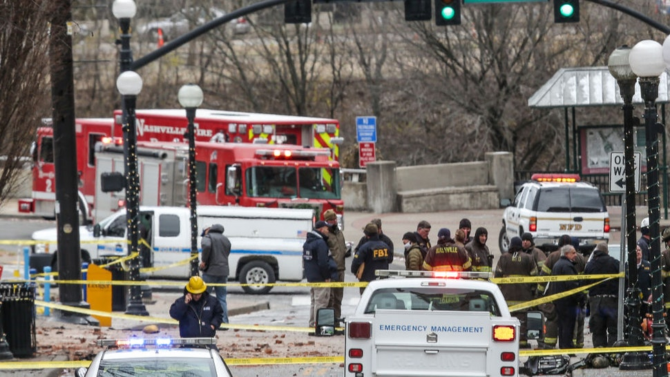 NASHVILLE, TN - DECEMBER 25: FBI and first responders work on the scene after an explosion on December 25, 2020 in Nashville, Tennessee. According to initial reports, a vehicle exploded downtown in the early morning hours