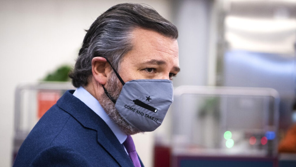 UNITED STATES - DECEMBER 9: Sen. Ted Cruz, R-Texas, talks with reporters in the Senate subway during a Senate vote in the Capitol on Wednesday, December 9, 2020.