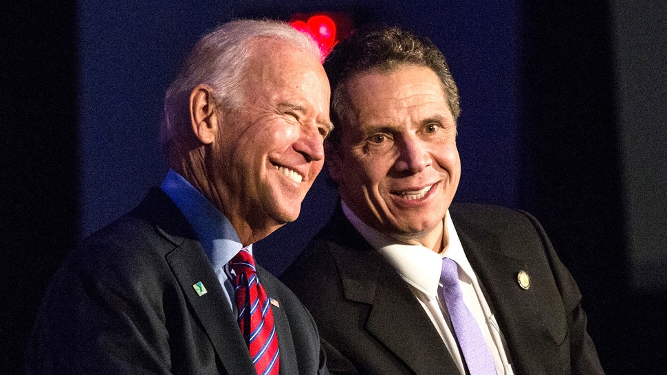 NEW YORK, NY - JANUARY 29: U.S. Vice President Joe Biden (L) and New York Governor Andrew Cuomo attend a rally for paid family leave on January 29, 2016 in New York City. The rally was attended by many union workers and included speakers Vice President Joe Biden, New York Governor Andrew Cuomo, U.S. Representative Carolyn Maloney (D-NY 12th District) and former model Christy Turlington.
