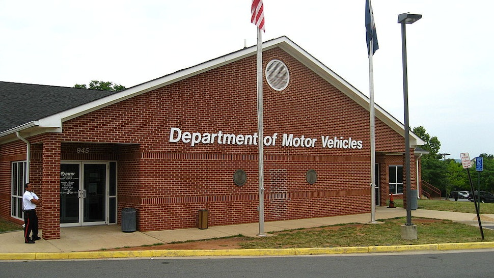 An Ashburn woman ran her silver Honda Civic into the left side of the Virginia Department of Motor Vehicles customer service center in Leesburg today. The car crashed into a stalk room. No one was injured. (Kafia Hosh/The Washington Post via Getty Images)