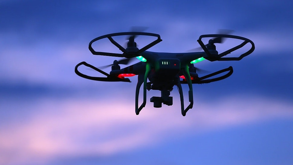 OLD BETHPAGE, NY - AUGUST 30: A drone is flown for recreational purposes in the sky above Old Bethpage, New York on August 30, 2015.