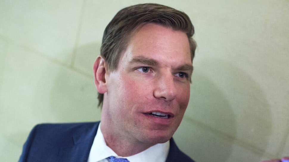 UNITED STATES - NOVEMBER 28: Rep. Eric Swalwell, D-Calif., talks with a reporter outside the House Democrats' leadership elections in Longworth Building on November 28, 2018.