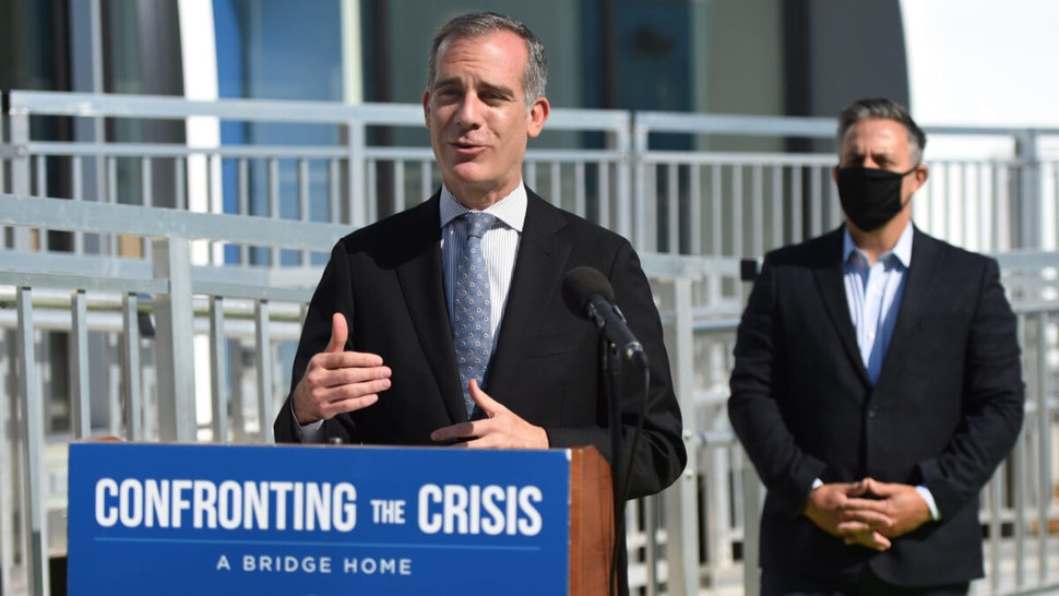 """Los Angeles Mayor Eric Garcetti speaks to those gathered for the official opening of the City""""u2019s 16th A Bridge Home shelter which will house 100 adults experiencing homelessness in San Pedro on Monday, July 6, 2020."""