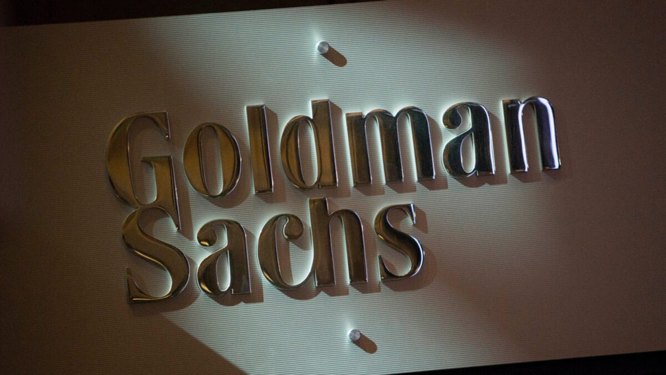 The Goldman Sachs & Co. logo is displayed at the company's booth on the floor of the New York Stock Exchange (NYSE) in New York, U.S., on Friday, July 19, 2013.