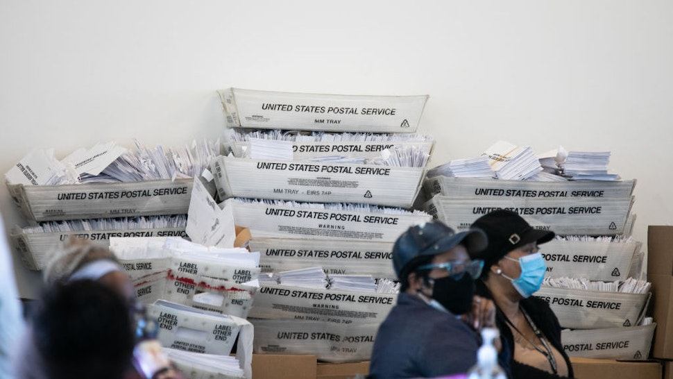 ATLANTA, GA - NOVEMBER 06: Security envelopes for absentee ballots sit in stacked boxes as Fulton county workers continue to count absentee ballots at State Farm Arena on November 6, 2020 in Atlanta, Georgia. The 2020 presidential race between incumbent U.S. President Donald Trump and Democratic nominee Joe Biden is still too close to call with outstanding ballots in a number of states including Georgia. (Photo by Jessica McGowan/Getty Images)