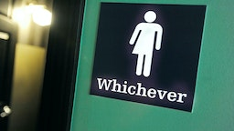 A gender neutral sign is posted outside a bathrooms at Oval Park Grill on May 11, 2016 in Durham, North Carolina. (Photo by Sara D. Davis/Getty Images)