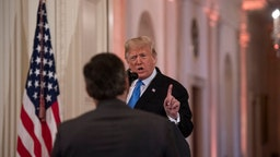 WASHINGTON, DC - NOVEMBER 7: President Donald Trump speaks to Jim Acosta of CNN during a press conference in the East Room of the White House in Washington, D.C. on November 7, 2018.