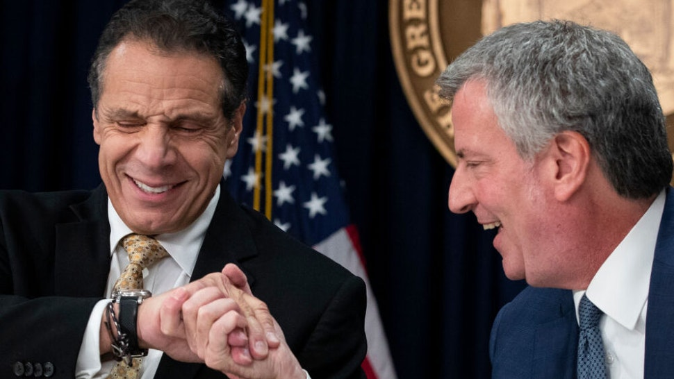 NEW YORK, NY - NOVEMBER 13: (L-R) New York Governor Andrew Cuomo and New York City Mayor Bill de Blasio shake hands during a press conference to discuss Amazon's decision to bring a new corporate location to New York City, November 13, 2018 in New York City. Amazon announced earlier in the day that it has chosen Arlington, Virginia and Long Island City in Queens as the two locations, which will both serve as additional headquarters for the company. Amazon says each location will create 25,000 jobs.