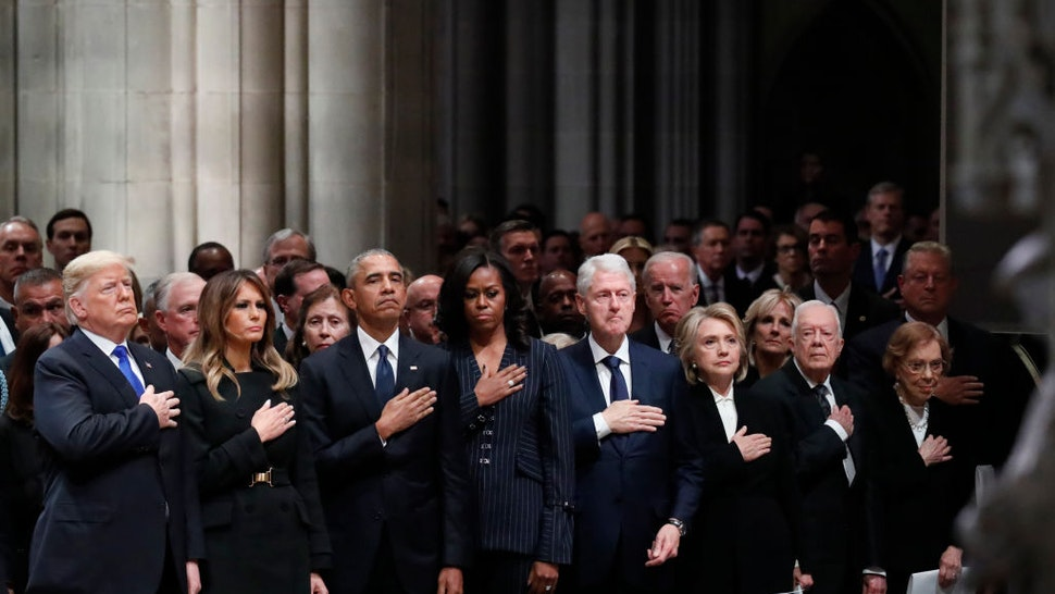 WASHINGTON, DC - DECEMBER 05: (AFP OUT) From left, President Donald Trump, first lady Melania Trump, former President Barack Obama, former first lady Michelle Obama, former President Bill Clinton, former Secretary of State Hillary Clinton, and former President Jimmy Carter and former first lady Rosalynn Carter attend the state funeral of former U.S. President George H. W. Bush at the Washington National Cathedral on December 5, 2018 in Washington, DC. President Bush will be buried at his final resting place at the George H.W. Bush Presidential Library at Texas A&M University in College Station, Texas. A WWII combat veteran, Bush served as a member of Congress from Texas, ambassador to the United Nations, director of the CIA, vice president and 41st president of the United States. (Photo by Alex Brandon - Pool/Getty Images)
