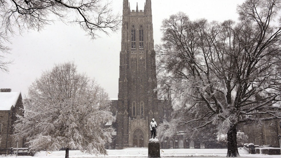 A general view of the Duke Chapel on the campus of Duke University as snow falls from Winter Storm Diego on December 9, 2018 in Durham, North Carolina.