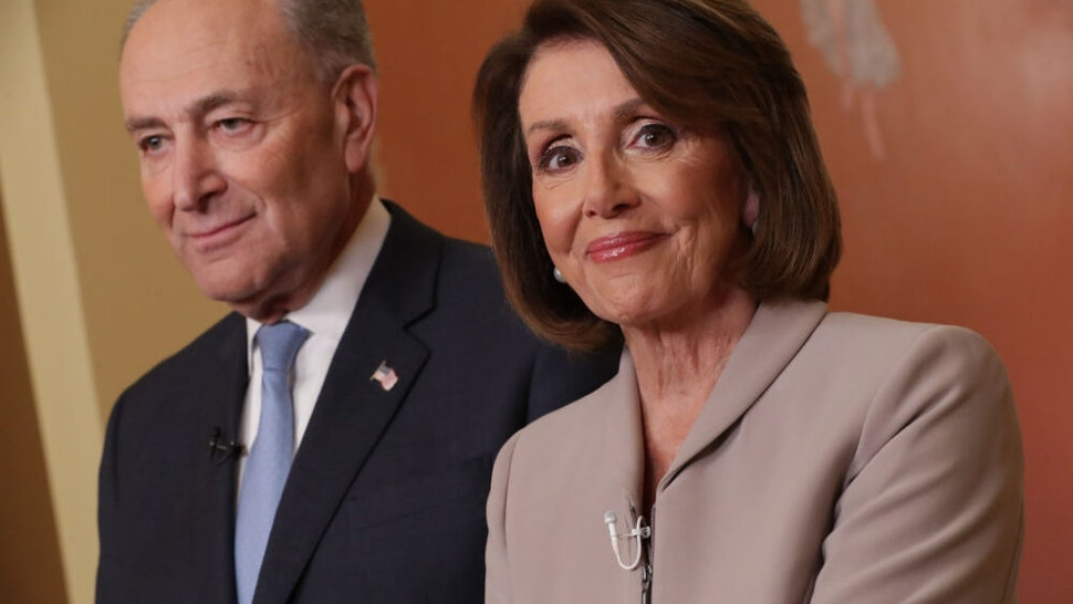 WASHINGTON, DC - JANUARY 08: Speaker of the House Nancy Pelosi (D-CA) and Senate Minority Leader Charles Schumer (D-NY) pose for photographs after delivering a televised response to President Donald Trump's national address about border security at the U.S. Capitol January 08, 2019 in Washington, DC. Republicans and Democrats seem no closer to an agreement on security along the southern border and ending the partial federal government shutdown, the second-longest in history.