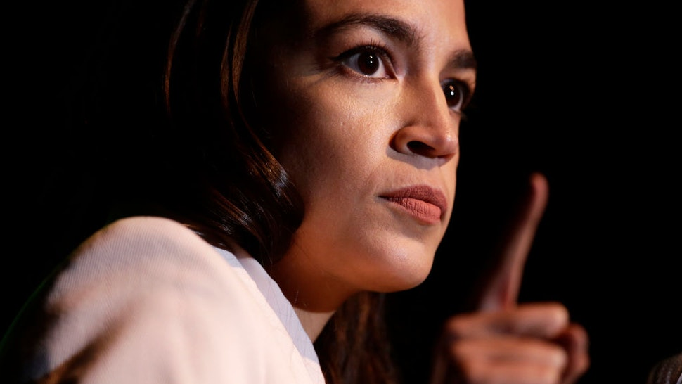 """WASHINGTON, DC - MAY 13: U.S. Rep. Alexandria Ocasio-Cortez (D-NY) speaks during a rally at Howard University May 13, 2019 in Washington, DC. The Sunrise Movement held an event for the final stop of the """"Road to a Green New Deal"""" tour to """"explore what the pain of the climate crisis looks like in D.C. and for the country and what the promise of the Green New Deal means."""" (Photo by Alex Wong/Getty Images)"""