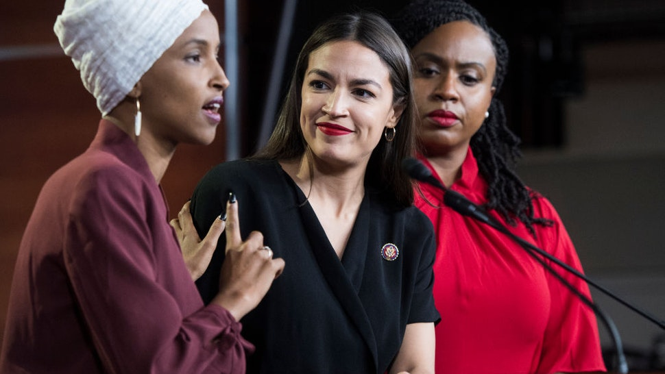 From left, Reps. Ilhan Omar, D-Minn., Alexandria Ocasio-Cortez, D-N.Y., and Ayanna Pressley, D-Mass., conduct a news conference in the Capitol Visitor Center responding to negative comments by President Trump that were directed at the freshmen House Democrats on Monday, July 15, 2019.