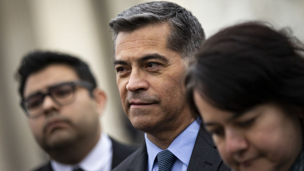 Xavier Becerra, California's attorney general, listens during a news conference outside the Supreme Court in Washington, D.C., U.S., on Tuesday, Nov. 12, 2019. The Supreme Court hears arguments today over the Obama-era Deferred Action for Childhood Arrivals program (DACA) which the Trump administration wants to undo. Photographer: Al Drago/Bloomberg via Getty Images