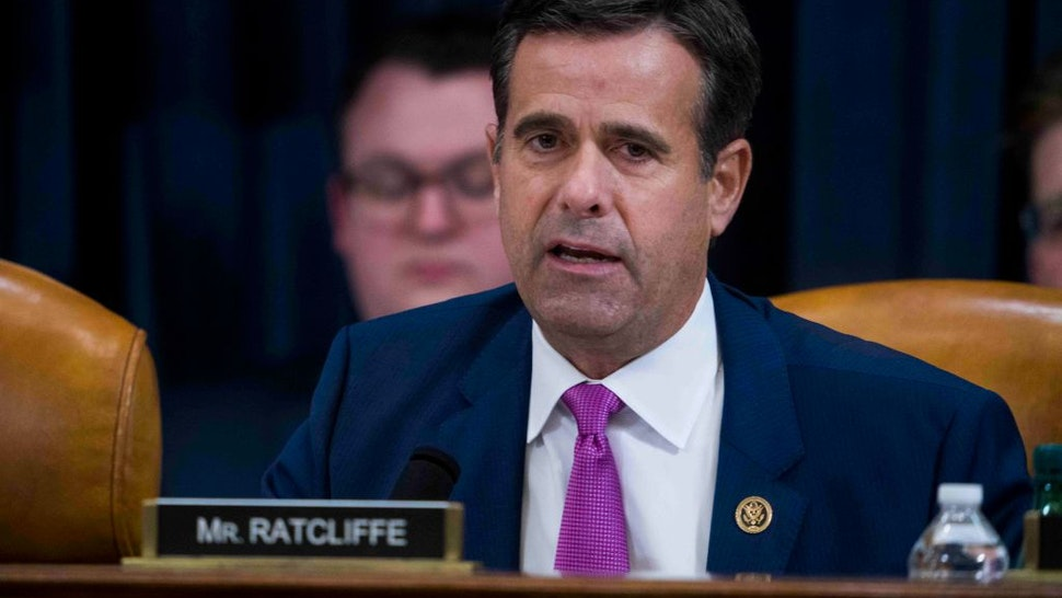 Rep. John Ratcliffe (R-TX) questions Intelligence Committee Minority Counsel Stephen Castor and Intelligence Committee Majority Counsel Daniel Goldman during the House impeachment inquiry hearings in the Longworth House Office Building on Capitol Hill December 9, 2019 in Washington, DC.