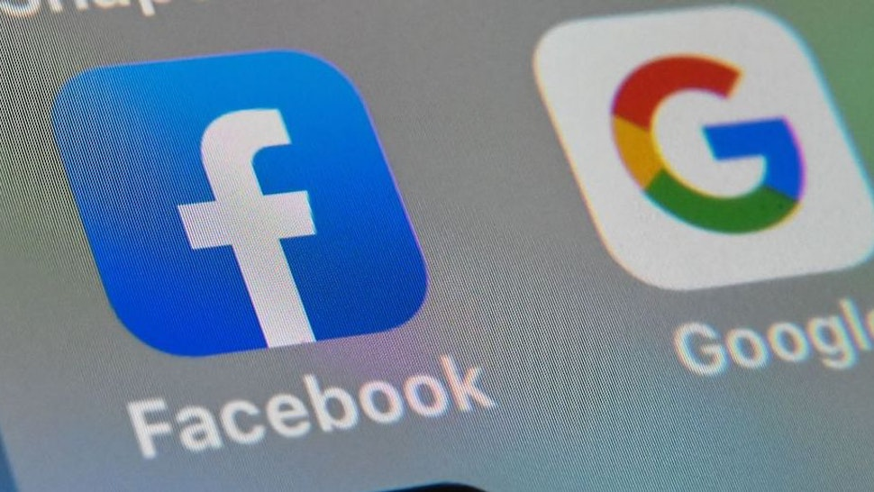 This file photo taken on October 1, 2019, shows the logos of mobile apps Facebook and Google displayed on a tablet in Lille, France