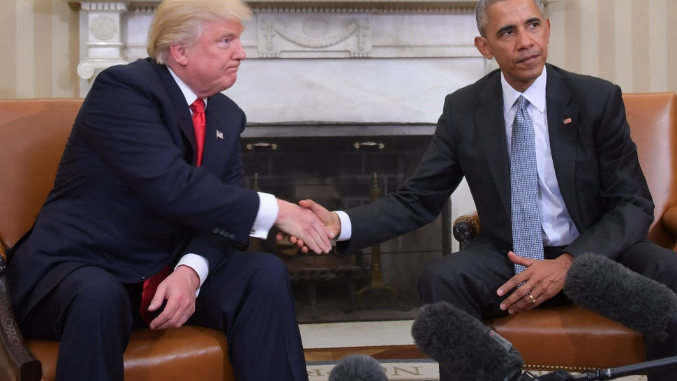 In this file photo taken on November 10, 2016, US President Barack Obama and President-elect Donald Trump shake hands during a transition planning meeting in the Oval Office at the White House in Washington, DC.