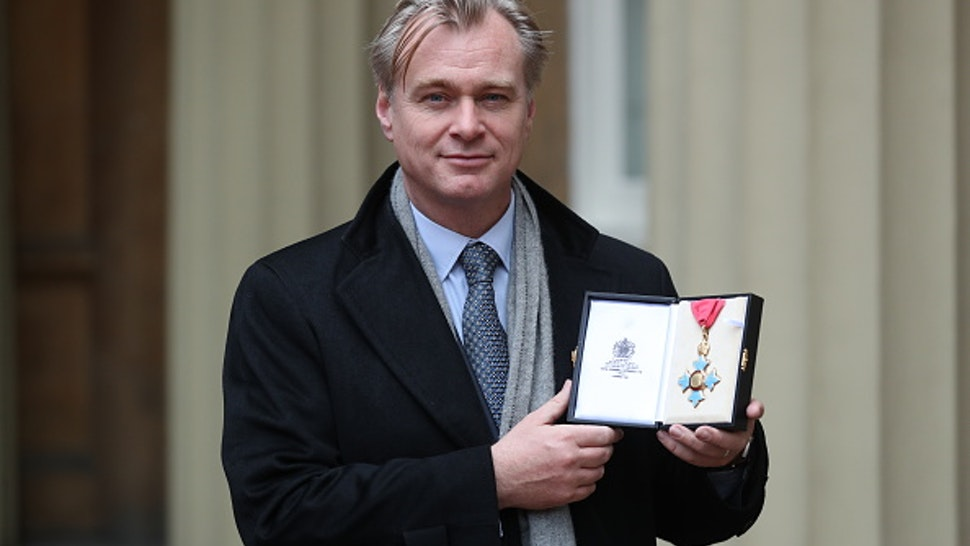 LONDON, ENGLAND - DECEMBER 19: Director Christopher Nolan after he was made a Commander of the British Empire (CBE) following an investiture ceremony at Buckingham Palace on December 19, 2019 in London, England.
