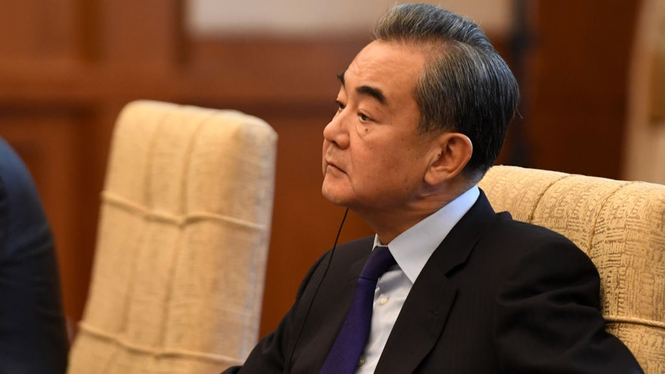 China's Foreign Minister Wang Yi listens to Iran's Foreign Minister Mohammad Javad Zarif (not pictured) during a meeting at the Diaoyutai state guest house on December 31, 2019 in Beijing, China.